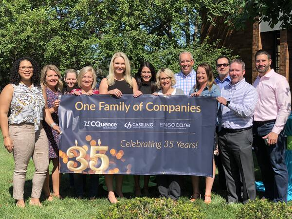 Cassling 35 Year Banner with Team Members