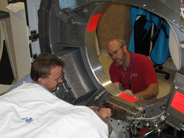 Jerry Glenn fixing a CT scanner