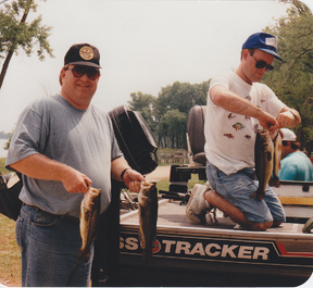 Jerry Glenn and Bill Herren showing off their catches after a fishing trip
