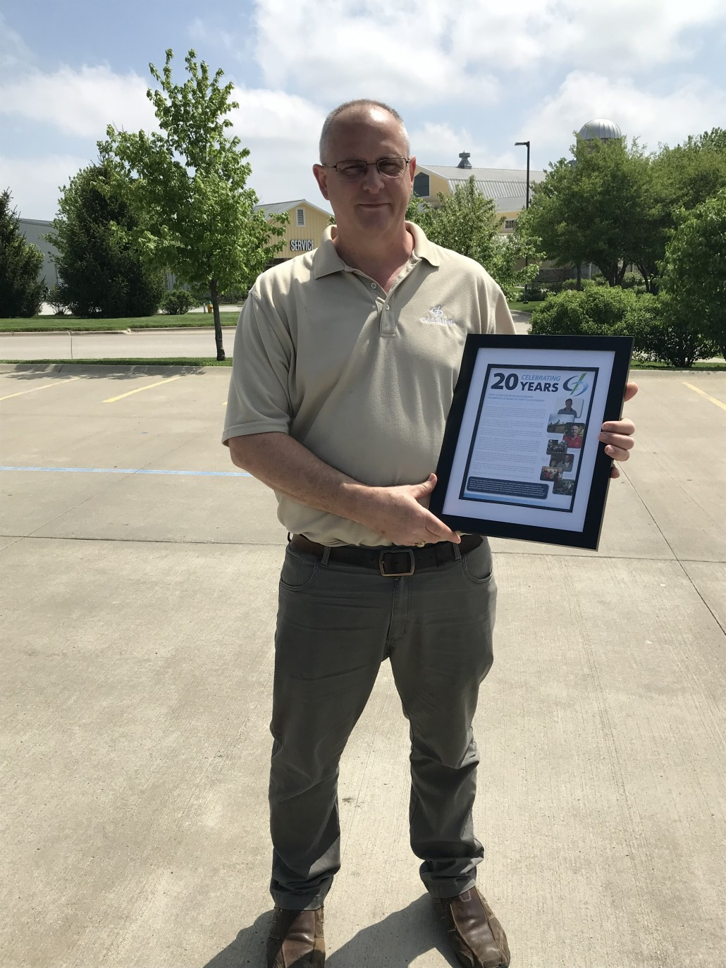 Kevin Richardson with Plaque