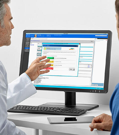 physicians looking at CDSM screen