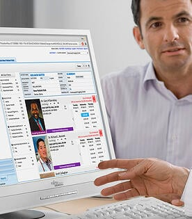 physician referencing Medicalis CDS portal